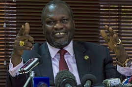 FILE - South Sudan's rebel leader Riek Machar gestures as he holds a press conference.