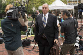 Paul Manafort's lawyer Thomas Zehnle (C) is surrounded by media as he arrives at the courthouse in Alexandria, Virginia on July 31, 2018.