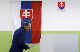 Radoslav Prochazka, a leader of Siet party, arrives to cast his vote at a polling station during the country's parliamentary election in Trnava, Slovakia, March 5, 2016.