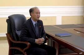 In this image made from video, Pang Kwang Hyok, vice director of the department of international organizations at the North Korean Ministry of Foreign Affairs, speaks during an interview with The Associated Press Television in Pyongyang, North Korea,