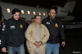 """Mexico's top drug lord Joaquin """"El Chapo"""" Guzman is escorted as he arrives at Long Island MacArthur airport in New York, Jan. 19, 2017, following his extradition from Mexico."""
