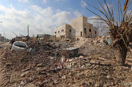 Destruction is seen around the Udai hospital following airstrikes on the town of Saraqeb in Syria's northwestern province of Idlib, Jan. 29, 2018. Syrian troops had been advancing on Idlib as part of a fierce offensive launched in late December with