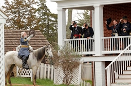 Period-costumed actor of General Robert E. Lee leaves after the surrender during the 150th anniversary re-enactment of the surrender of General Robert E. Lee to General Ulysses S. Grant at the Court House National Historic Park in Appomattox, Virgini...