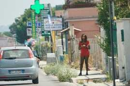 Nigerian streetwalker on the main street in Castel Volturno plying her trade. Italian authorities say one out of every two sex worker on the roads of Italy are Nigerian. (Photo: Jamie Dettmer for VOA)