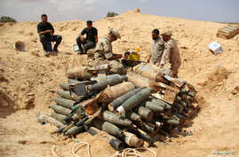 Libyan forces prepare to detonate and dispose of explosives and shells left behind by Islamic State militants in Sirte following a battle, in Misrata, Sept. 9, 2016.