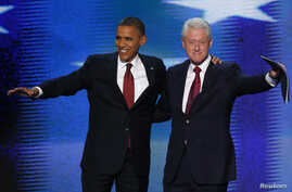 U.S. President Barack Obama (L) joins former President Bill Clinton onstage after Clinton nominated Obama for re-election during the second session of the Democratic National Convention in Charlotte, North Carolina, September 5, 2012.