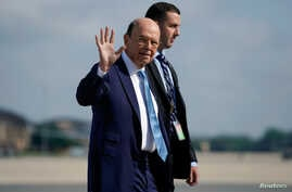 Secretary of Commerce Wilbur Ross boards Air Force One prior to departing Washington en route to Iowa from Joint Base Andrews, Maryland, July 26, 2018.