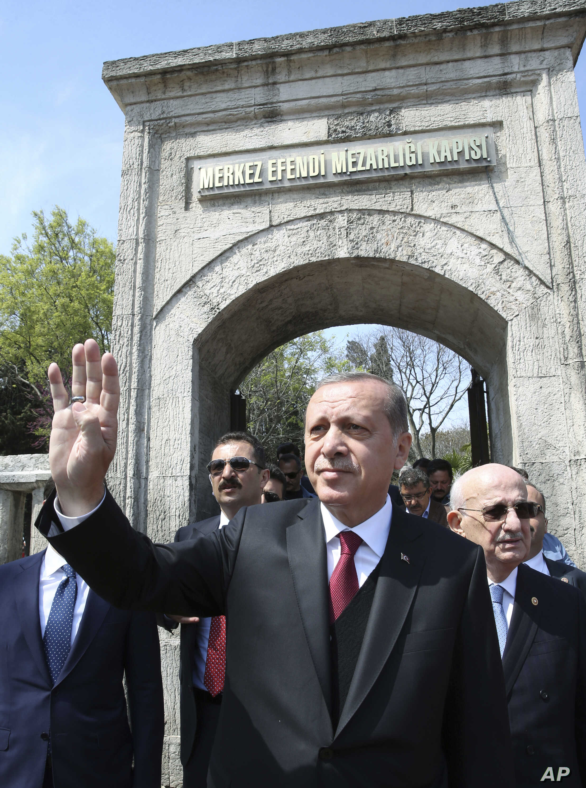Turkey's President Recep Tayyip Erdogan waves after he visited the graves of three conservative late Turkish prime ministers, in Istanbul, April 17, 2017.