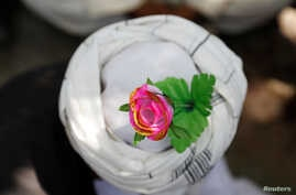An artificial flower is seen on a turban of a peace marcher as he arrives in Kabul, Afghanistan June 18, 2018. The release of Mullah Abdul Ghani Baradar, co-founder of the Taliban, by Pakistan could be part of efforts to advance a peace dialogue the