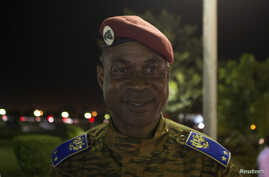FILE - Head of Burkina Faso's presidential guard Gilbert Diendere waits for his chauffeur to arrive after the swearing-in ceremony of newly named President Michel Kafondo in Ouagadougou November 21, 2014.
