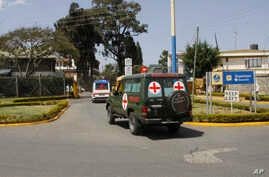 Bodies of Kenyan soldiers are transported by ambulances as they arrive at Wilson airport, Nairobi Kenya, Jan 27, 2017. A spokesman for extremist group al-Shabab says its fighters have killed at least 51 Kenyan soldiers in an attack on an army base in...