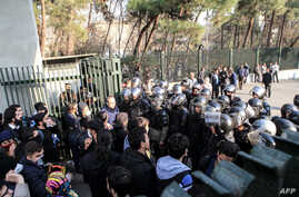 Iranian students scuffle with police at the University of Tehran during a demonstration driven by anger over economic problems, in the capital Tehran, Iran, Dec. 30, 2017.