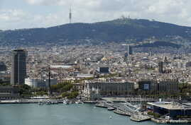 FILE - A view of Barcelona, with Maremagnum and Port Vell at habor, in Barcelona, Spain.