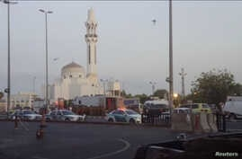 General view of security personnel in front of a mosque as police stage a second controlled explosion, after a suicide bomber was killed and two other people wounded in a blast near the U.S. consulate in Jeddah, Saudi Arabia, July 4, 2016.