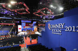Workers prepare the stage for the Republican National Convention inside the Tampa Bay Times Forum in Tampa, Florida, Aug. 25, 2012.