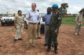 David Shearer, second left, the United Nations peacekeeping mission chief in South Sudan, visits the troubled region of Yei, South Sudan, July 13. 2017. Shearer says he's considering putting a permanent U.N. presence in the town, but only if the gove...