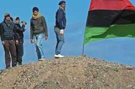 Libyan Rebels Gain Diplomatic Advance, but Retreat on Battlefield