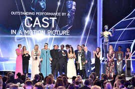"""Frances McDormand and the cast of """"Three Billboards Outside Ebbing, Missouri"""" accept the award for outstanding performance by a cast in a motion picture at the 24th annual Screen Actors Guild Awards at the Shrine Auditorium & Expo Hall on Sunday, Jan"""