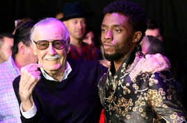 "FILE - Comic book legend Stan Lee (L), creator of the ""Black Panther"" superhero, poses with Chadwick Boseman, star of the new ""Black Panther"" film, at the premiere at The Dolby Theatre in Los Angeles, Jan. 29, 2018."