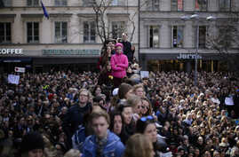 "Thousands of people attends a ""Lovefest"" vigil against terrorism in central Stockholm, Sweden, Sunday, April 9, 2017. A hijacked truck was driven into a crowd of pedestrians and crashed into the department store on Friday in the Swedish capital."