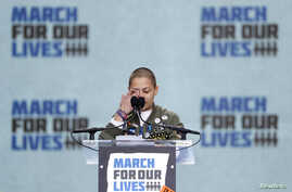 "Emma Gonzalez, a student and shooting survivor from the Marjory Stoneman Douglas High School in Parkland, Florida, cries as she addresses the conclusion of the ""March for Our Lives"" event demanding gun control at a rally in Washington, March 24, 2018"