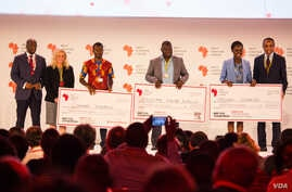 Dr. Conrad Tankou, Rachel Sibande and Dr. Abdoulaye Diallo stand on the stage at NEF holding the $25,000 checks that they won for their innovation prizes. The innovation was divided into three categories: personalized health, climate smart and deep t