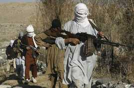 Taliban fighters in an undisclosed location in Nangarhar province, Afghanistan, December 13, 2010
