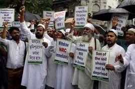 Activists of All Bengal Minority Youth Federation shout slogans as they protest against the final draft of the National Register of Citizens (NRC) in the northeastern state of Assam, in Kolkata, India, July 31, 2018.