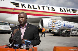Augustine Ngafuan, Minister of Foreign Affairs of Liberia, speaks to the media as a 747 aircraft is loaded with supplies, including 100 tons of emergency medical aid, at New York's John F. Kennedy International Airport, Sept. 20, 2014.