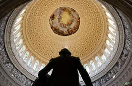 The Capitol Rotunda is seen with the statue of George Washington on Capitol Hill in Washington, Jan. 30, 2018, ahead of the State of the Union address by President Donald Trump.