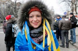 Maria, a physician, attends a rally in downtown Kyiv, Ukraine, Dec. 4, 2013.