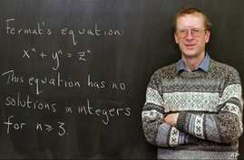 "Princeton University mathematics professor Andrew John Wiles poses next to ""Fermat's Last Theorem"" written on a chalkboard in his Princeton, N.J., office Tuesday, Jan. 6, 1998."
