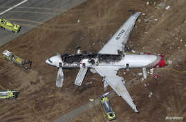 An Asiana Airlines Boeing 777 plane is seen in this aerial image after it crashed while landing at San Francisco International Airport in California on July 6, 2013. Two people were killed and 130 were hospitalized after the plane crash-landed at San