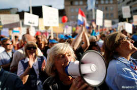 """A woman takes part in a protest billed """"Croatia can do better,"""" against what demonstrators say is political meddling in education reform, on Zagreb's main square, Croatia, June 1, 2016."""