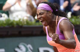 TOPSHOTSUS player Serena Williams celebrates after winning her match against Germany's Anna-Lena Friedsam during the women's second round of the Roland Garros 2015 French Tennis Open in Paris on May 28, 2015. Williams won the match 5-7, 6-3, 6-3.  AF...