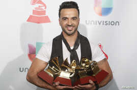 """Luis Fonsi holds his awards for Song of the Year, Record of the Year and Best Long Form Music Video for """"Despacito"""" and Best Urban Fusion/Performance for  """"Despacito (Remix)."""""""