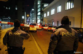Police stand outside an Islamic center in central Zurich, Switzerland, Dec. 19, 2016.