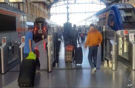 This image taken from video shows passengers inside Marseille-Saint-Charles railway station in Marseille, France, Sept. 17, 2017.