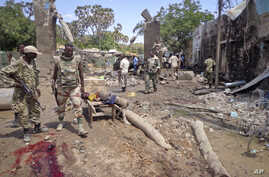 Security forces attend to the scene following a car bomb attack in Beledweyne, Somalia Tuesday, Nov. 19, 2013.
