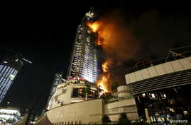 Flames whip through the Address Downtown Dubai hotel in the United Arab Emirates, Dec. 31, 2015.