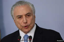 Brazil's President Michel Temer delivers a speech after deputies of the lower chamber of Brazil's Congress voted to reject a corruption charge against him at the Planalto Palace in Brasilia, Brazil, Aug. 2, 2017.