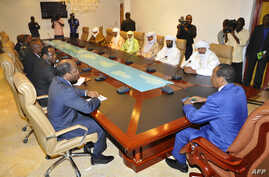 Burkina Faso President Blaire Compaore (R), the top mediator in Mali's crisis, and his delegation meet at the presidential palace in Ouagadougou with rebel leaders (R) from the Islamist Ansar Dine, one of the groups controlling the country's north, J