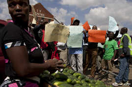 FILE - Workers are seen holding placards during a labor protest in Harare, Zimbabwe.