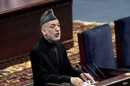 Afghan President Hamid Karzai speaks during the first day of the Loya Jirga in Kabul, Afghanistan, Nov. 21, 2013.