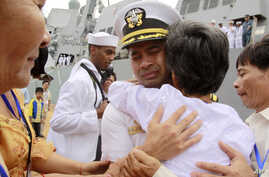 """In this photo taken Dec. 3, 2010, U.S. navy officer Michael """"Vannak Khem"""" Misiewicz becomes emotional as he embraces his aunt Samrith Sokha, 72, at Cambodian coastal international see port of Sihanoukville, Cambodia."""
