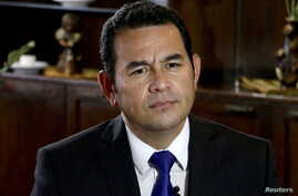 Jimmy Morales, Guatemala's independent presidential candidate, looks on during an interview with Reuters in Guatemala City, Aug. 20, 2015.