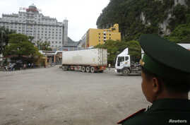 A guard monitors people and container trucks crossing the Tan Thanh border gate with China in Vietnam's northern Lang Son province July 30, 2014.