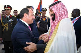Egyptian President Abdel-Fattah el-Sissi, left, greets Saudi Crown Prince Mohammed bin Salman on his arrival to Cairo, Egypt, for a visit meant to deepen the alliance between two of the region's powerhouses, Sunday, March 4, 2018.