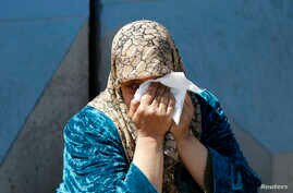 A Palestinian woman who fled the violence in Syria reacts during a sit-in in front of the United Nations Relief and Works Agency (UNRWA) in Beirut, Lwbanon, March 21, 2013.