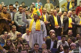 Supporters of former Iraqi Kurdistan region's President Masoud Barzani, shout slogans ahead of regional elections in Erbil, Iraq, Sept. 11, 2018.